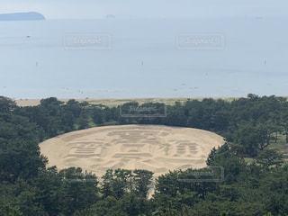 観音寺琴引海岸にある砂の寛永通宝の写真・画像素材[3231751]