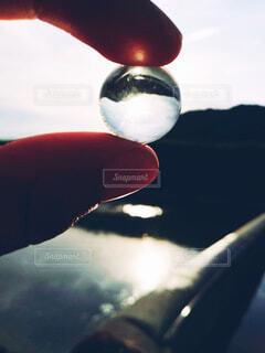 ビー玉と夕日の写真・画像素材[3974179]