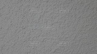 テクスチャの入った単色グレーの背景の写真・画像素材[3340077]