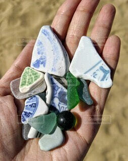 海,手,手持ち,人物,人,ポートレート,陶器,ビー玉,手元,シー陶器