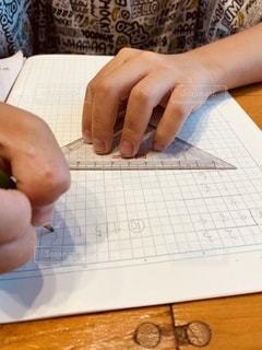 割り算の筆算はノートのスペースめっちゃ使うのが嫌だそうですの写真・画像素材[3362594]