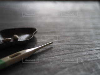 体温計と薬の写真・画像素材[3458132]