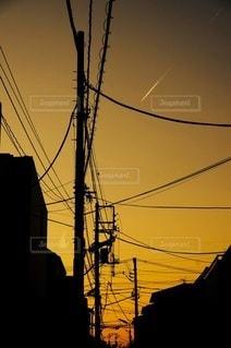 都市に沈む夕日の写真・画像素材[3470301]