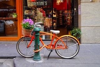 オレンジの自転車の写真・画像素材[3441032]