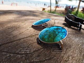 砂浜に横たわっている人の写真・画像素材[3644451]