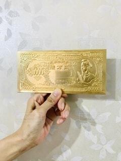 手持ち,人物,おもちゃ,手元,金の一万円札