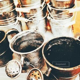 コーヒーカップを近付けの写真・画像素材[3632189]