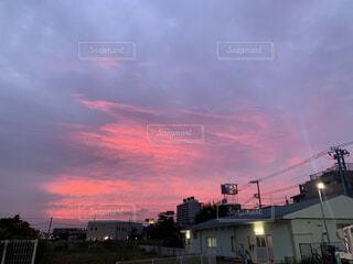 都市に沈む夕日の写真・画像素材[3701182]