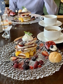 食べ物の皿とコーヒーをパンケーキの写真・画像素材[3686116]