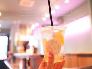 オレンジ ジュースのガラスの写真・画像素材[928129]
