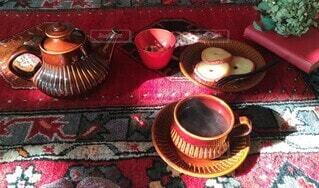 絨毯の上でお茶の写真・画像素材[3900460]