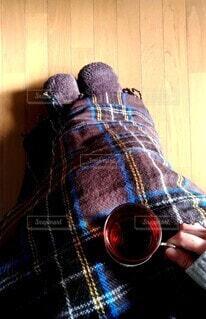 電気毛布とフリーススリッパで防寒の写真・画像素材[3938581]