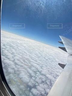 飛行機からみる空の写真・画像素材[3899256]
