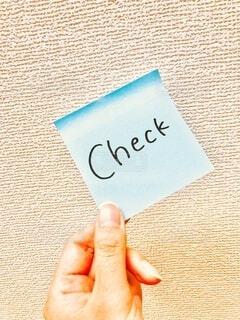 指先でCheckの写真・画像素材[3879777]