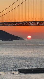 明石海峡と、だるま夕日の絶品コラボの写真・画像素材[4015845]