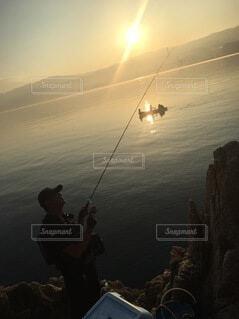 空,屋外,太陽,水面,正月,釣り,お正月,日の出,明るい,新年,初日の出,釣り竿