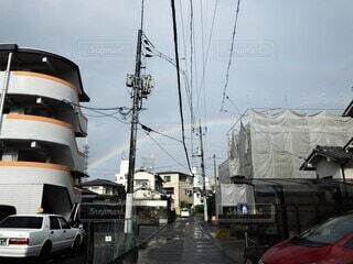 空にかかる虹の写真・画像素材[4062774]