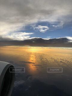 空,夕日,屋外,雲,飛行機,昼夜逆