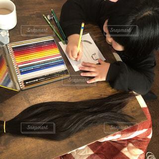 どこかの誰かに髪の毛のプレゼントの写真・画像素材[4391571]