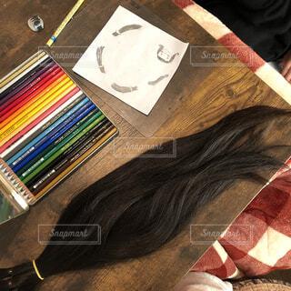 どこかの誰かに髪の毛のプレゼントの写真・画像素材[4391573]