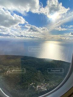 飛行機の窓からの写真・画像素材[4431463]
