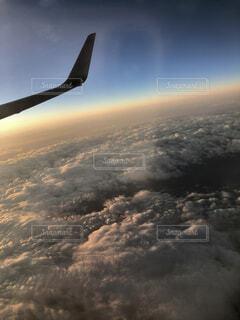 空,屋外,雲,夕焼け,飛行機,飛ぶ,夕陽,空中,航空機,空気,空の旅,航空