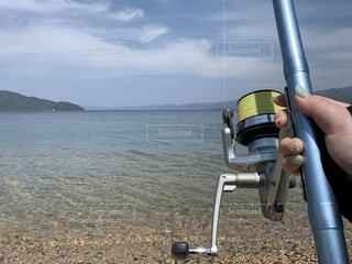 海,空,屋外,ビーチ,砂浜,水面,人物,人,釣り,魚釣り