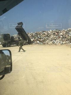 山,トラック,広場,自衛隊,災害,ゴミ,ダンプ,災害ゴミ