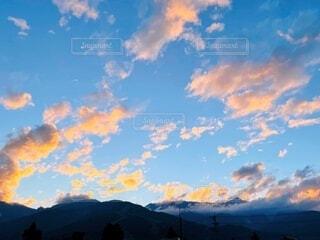 北アルプスと夕焼けの写真・画像素材[4874209]