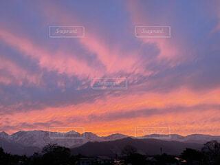 北アルプスと夕陽の写真・画像素材[4874217]