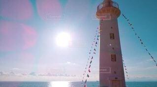 太陽の光でピンクに光る灯台の写真・画像素材[4948852]