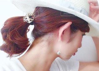 帽子をかぶっている女性の写真・画像素材[1617612]