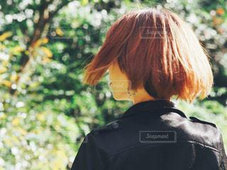 風邪がふわり髪がなびくの写真・画像素材[1585455]