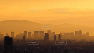 空,建物,大阪,太陽,夜明け,シルエット,光,タワー,朝焼け,高層ビル,日の出,初日の出,スカイライン,大都会,元日