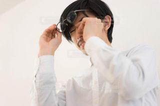 携帯電話で話す男性の写真・画像素材[1826432]
