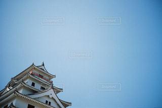 バック グラウンドでの時計塔の写真・画像素材[722389]