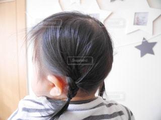 みつ編みの女の子の写真・画像素材[1045653]