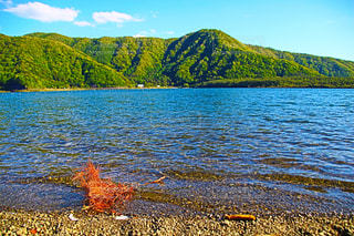 背景の山と水体の写真・画像素材[1163317]
