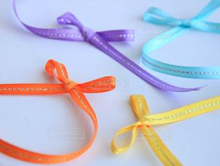 春,カラフル,紫,黄色,水色,オレンジ,リボン,ムラサキ,オレンジ色,パステルカラー,紫色,りぼん,ライトブルー