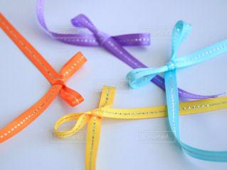 春,カラフル,紫,黄色,水色,オレンジ,リボン,イエロー,ムラサキ,オレンジ色,パステルカラー,紫色,りぼん,ライトブルー