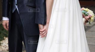 2人,カップル,ドレス,夫婦,ブーケ,ウエディング,手つなぎ,タキシード,ツーショット