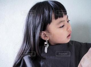 イヤリングと女の子の写真・画像素材[3131580]