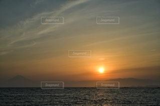 富士山のシルエットと夕日と。の写真・画像素材[3399981]