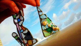 猫,海,空,夏,アクセサリー,雲,晴れ,青空,晴天,水色,木漏れ日,ガラス,ステンドグラス,貝,ハンドメイド,三角,手作り,鴨川,おそろい,はじめて,シーグラス,ツーショット,はんだごて