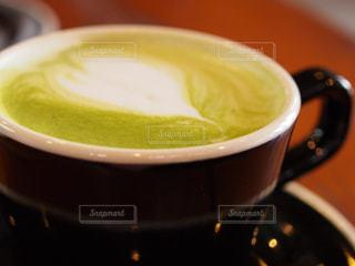 テーブルの上のコーヒー カップの写真・画像素材[932737]