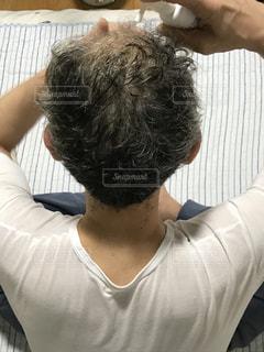 シューシュー育毛中の写真・画像素材[1527828]
