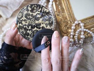 コインを持っている手の写真・画像素材[3097291]