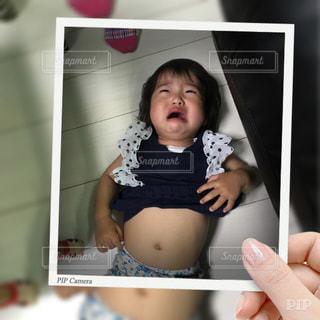 悲しい顔の写真・画像素材[486940]