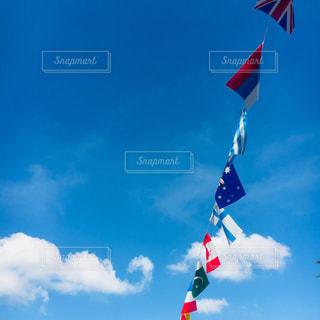 秋,スポーツ,雲,青空,青,爽やか,運動会,秋空,万国旗,フォトジェニック,多色
