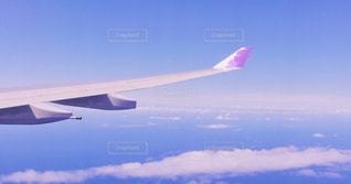 大型航空機を空中に高く飛ぶの写真・画像素材[1247521]